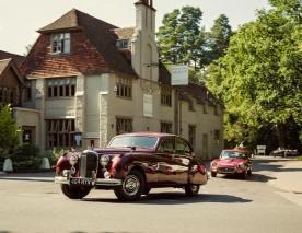 Behind the wheel of H.M. Queen Elizabeth the Queen Mother's Mk7 Jaguar, upgraded to Mk9 to spec